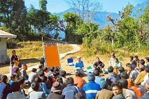 Preserving nature: Sandeep Tambe (centre) addressing villagers in Sikkim.