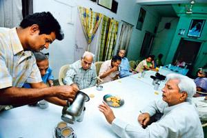 Grey area: Residents of an old-age home in the Capital gather in the dining hall for a tea break. Photo by Pradeep Gaur/Mint.