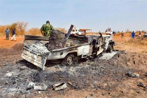 Feuding neighbours: A file photo of a burnt military vehicle in Sudan's southern oil centre of Heglig after South Sudanese troops and government forces clashed, sparking international alarm. AFP