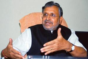 Speedy resolution: Chairman of the empowered committee of state finance ministers Sushil Kumar Modi says the Constitution Amendment Bill may be tabled in the winter session of Parliament. By AP Dube/H