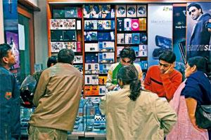 Accessible medium: A file photo of customers at a mobile phone store in New Delhi. According to IAMAI, India has the second largest population of cellphone users and 15% of them access the Internet on