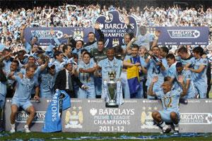 The Manchester City team celebrate winning the English Premier League following their soccer match against Queens Park Rangers at the Etihad Stadium in Manchester. Reuters