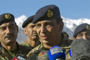 In this 18 April 2012 file photo, Pakistan's army chief Gen. Ashfaq Parvez Kayani talks with reporters after visiting a Siachen area at Skardu, Pakistan. AP