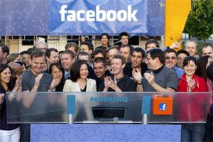 Mark Zuckerberg, CEO of Facebook Inc., (C) applaud after remotely ring the opening bell for trading at the Nasdaq MarketSite from the Facebook campus in Menlo Park, California on Friday. Bloomberg.