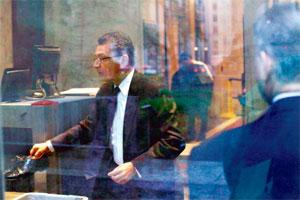 Trial begins: Rajat Gupta undergoes a security check before entering the federal courthouse in New York on Monday for the hearing on the insider-trading case. Eduardo Munoz/Reuters.