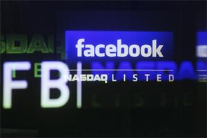 The Facebook logo is seen on a screen inside at the Nasdaq Marekstsite in New York. Reuters