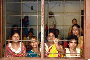 Nowhere to go: Mentally ill women staring out of a room at the Capernaum Charitable Trust in Kochi. Sivaram V/Mint