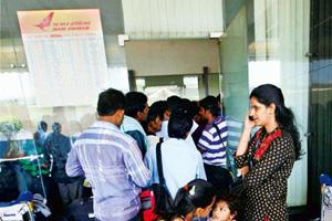 Wait continues: Passengers wait outside the booking office at Mumbai airport. The pilots' strike at the state-run national carrier entered the 16th day on Wednesday, with the revenue loss thus far put