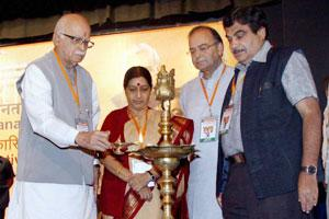 Senior BJP leader L. K. Advani with Nitin Gadkari, Sushma Swaraj and Arun Jaitley lighting the lamp during the inauguration of the party's National Executive Meeting in Mumbai on Thursday. PTI photo