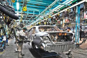 Held up: Honda Siel's facility in Greater Noida. Over 50% of the plant's capacity of 120,000 cars a year remains unutilized. Photo: Ramesh Pathania/Mint