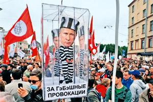 Banner of protest: Activists carry a model of a prison cell with the cut-out figure of President Vladimir Putin during a rally against his third term in Russia on Tuesday. (Olga Maltseva/AFP)