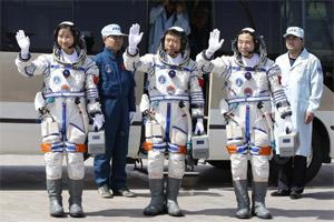 Chinese Astronauts Jing Haipeng, Liu Wang And Liu Yang Wave During A Departure Ceremony At The Jiuquan Satellite Launch Center (Reuters)