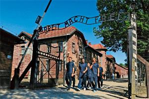 Remembrance: Jack Butland (from left), Andy Carroll, Wayne Rooney and Joe Hart visiting the Auschwitz-Birkenau memorial as part of an England Football Association delegation earlier this month. Hamish