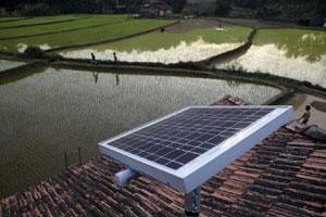 A solar panel stands on the roof of a house in Halliberu village, Karnataka. (Bloomberg)