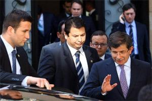 Turkey's foreign minister Ahmet Davutoglu (R) leaves a meeting focused on Syria with army generals and other officials on Syria, in Ankara . AFP