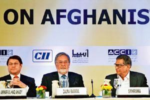 Playing facilitator: (Left to right) Afghanistan commerce minister Anwar-ul-Haq Ahady, Afghan foreign minister Zalmai Rassoul and his Indian counterpart S.M Krishna in New Delhi. AP