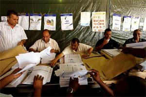 High Election commission workers prepare voting forms to be distributed to polling stations, at a shed in Maatika airport, Tripoli . Photo by Reuters.