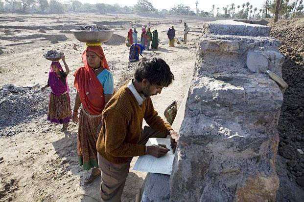 Villagers build a wall around a dried pond under the NREGA in Rajasthan. File photo