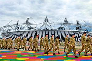 Contingency plan: Troops at the site of the London 2012 Olympics. Officials are already under pressure over the failure of security contractor G4S to deliver some 10,400 personnel to protect stadiums