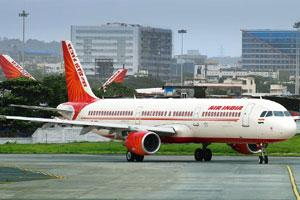 Falling short: An Air India aircraft at the Mumbai International Airport. The airline could clock only nine hours of aircraft utilization in the June quarter against the government benchmark of 14 hou
