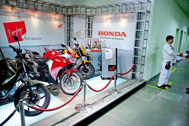Racing ahead: Motorcycles produced by Honda Motorcycle & Scooter India are displayed in the reception of the company's plant in Manesar. Photo: Bloomberg