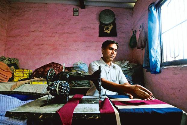 Karan Singh, a flag maker in east Delhi's Aradhak Nagar colony