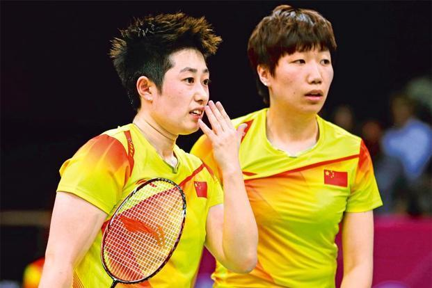 In trouble: China's players Yu Yang (left) and Wang Xiaoli. Photo: Andres Leighton/AP