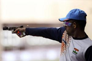 Vijay Kumar competes in the men's shooting 25m rapid fire pistol qualification round at the London 2012 Olympic Games. Photo: Reuters