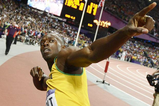 Jamaica's Usain Bolt celebrates after winning the men's 100m final at the athletics event during the London 2012 Olympic. Photo / AFP