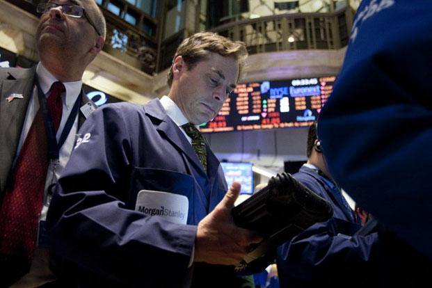 Traders work at the New York Stock Exchange. File Photo