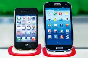 Patent row: Samsung's Galaxy S III, right, and Apple's iPhone 4S, on display at a mobile phone shop in Seoul in South Korea. Apple's battle with Samsung was in large measure a proxy war against Google