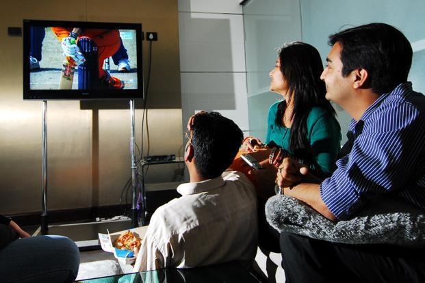 The gallery for indian people watching television for People watching