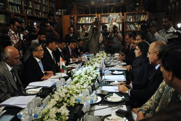 Indian foreign minister S.M. Krishna (second from left) and his Pakistani counterpart Hina Rabbani Khar (third from right) speak during a meeting in Islamabad on Friday. Photo: AFP (AFP)