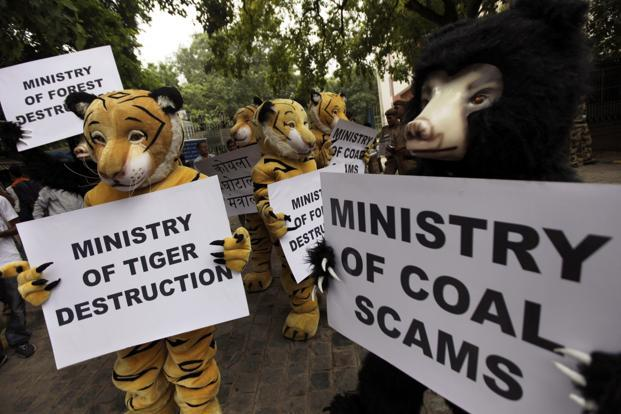 Greenpeace activists dressed as wild animals hold placards during a protest against the allocation of forest land for coal mining in New Delhi. AP