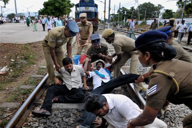 Police detain Viduthalai Chiruthaigal Katchi activists, part of a rail roko agitation in Coimbatore. The activists were protesting against the training of two Sri Lankan defence personnel in Wellington, Tamil Nadu. PTI