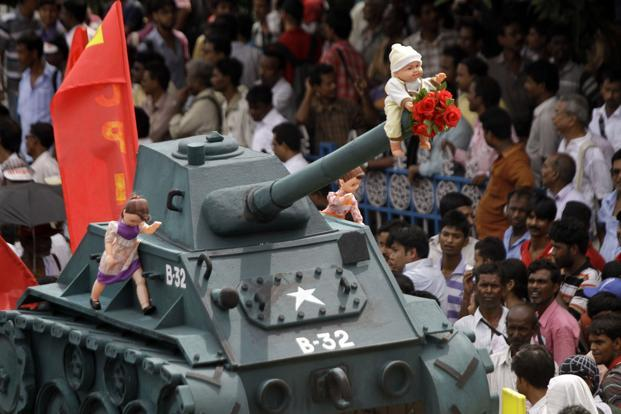 A tableau is taken out during a rally by Communist Party of India-Marxist cadre in Kolkata to protest against alleged worldwide US imperialism and increasing involvement of the US in Indian matters. AP