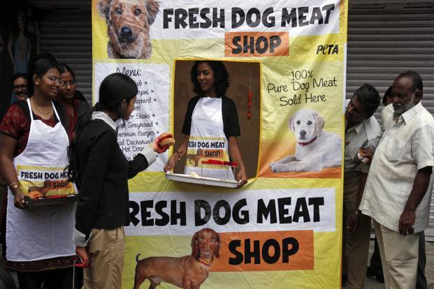 Activists of People for the Ethical Treatment of Animals (PETA)      set up a mock dog-meat shop in Hyderabad to protest the consumption of meat. (AP)