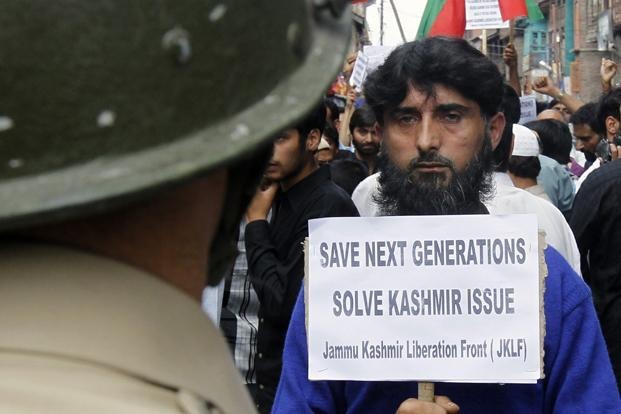 A member of the Jammu Kashmir Liberation Front (JKLF) at a demonstration in Srinagar held to press India and Pakistan to involve Kashmiri separatist leaders in peace talks and resolve the Kashmir issue on a priority basis. Reuters