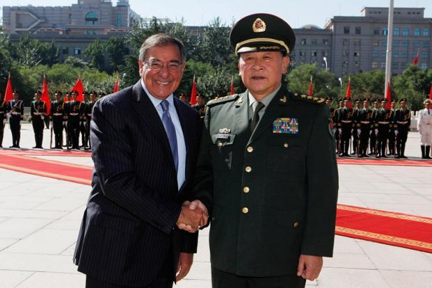 US secretary of defense Leon Panetta (L) shakes hands with China's defense minister Liang Guanglie during his visit to Beijing. Photo: AFP