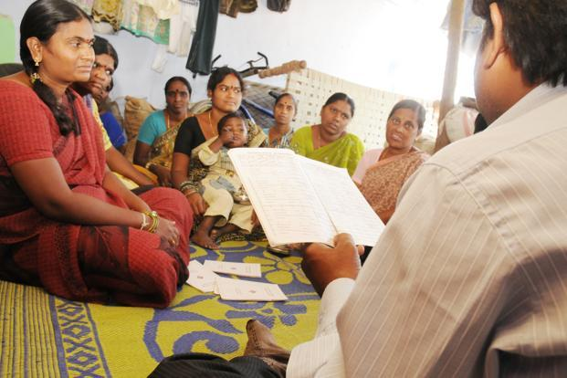 A file photo of microfinance borrowers at Domakonda village in Andhra Pradesh. By encouraging borrowers, often women, to form groups and replacing individual liability with group liability, MFIs have eliminated the need for extensive credit checks on individual clients. Photo: Mint (Mint)