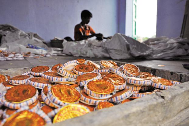 A worker makes crackers at a fireworks factory in Sivakasi. Photo: Pandiarajan/Mint