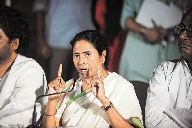Mamata Banerjee on Wednesday reiterated her demands—a cut in the diesel price, an increase in the cap on subsidized cooking gas cylinders, and complete withdrawal of the decision on FDI in multi-brand retail. Photo: AFP
