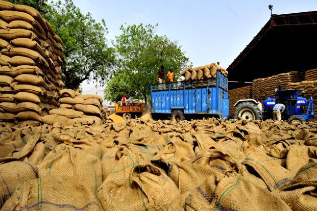Sacks of wheat at Balabhgarh Mandi in Faridabad, Haryana. Non-poor customers buy rice and wheat at nearly one-third the so-called economic cost price. Photo: Ramesh Pathania/Mint