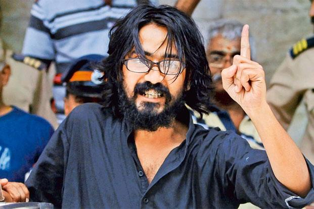 Aseem Trivedi after being arrested by the police in Mumbai. Photo: AP.