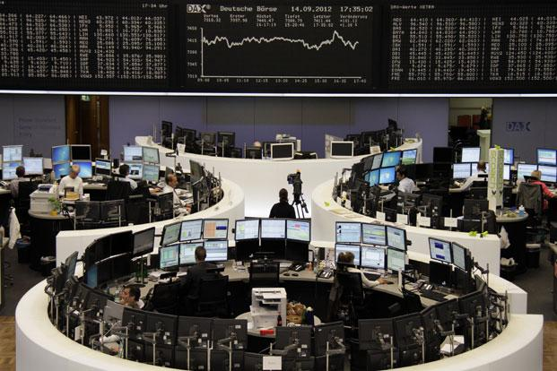 Traders at the Frankfurt stock exchange on Monday. German Bund futures inched up 15 ticks to 140.40 on fears that any Bundesbank challenge to ECB latest debt plan may delay its implementation. Photo: Amanda Andersen/Reuters (Amanda Andersen/Reuters)