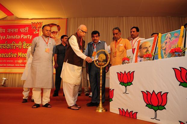 (From left) Arun Jaitley, L.K. Advani and Nitin Gadkari inaugurating the BJP national executive meeting in Surajkund on Wednesday. Photo: Ramesh Pathania/Mint
