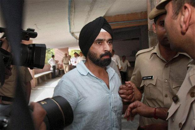 Reebok India's sacked MD Subhinder Singh Prem being produced at a district court in Gurgaon. Photo: PTI