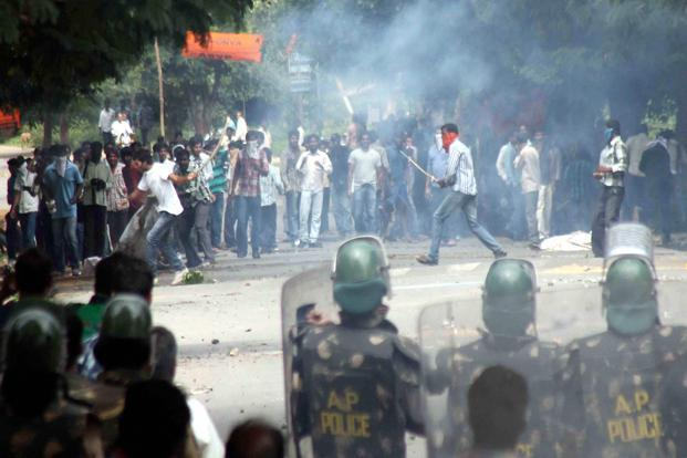 Police busted teargas on protestors during the Telangana march. Photo: PTI