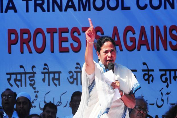 Mamata Banerjee addressing a rally in New Delhi on Monday. Banerjee said her party would agitate throughout the country against the government's decisions. Photo: Ramesh Pathania/Mint