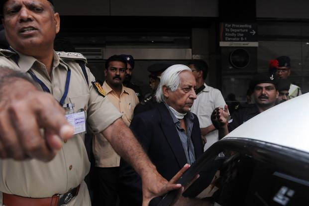 Lt Gen. (retired) Kuldip Singh Brar (centre) is escorted out of the Chattrapati Shivaji International Airport after his arrival from London in Mumbai on Wednesday. Photo: Indranil Mukherjee/AFP